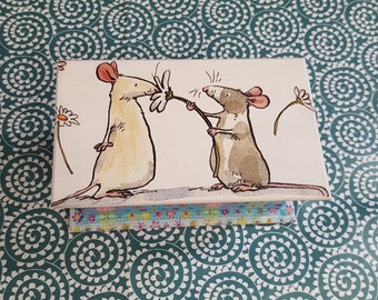 The two mice, towel, flowers wooden box