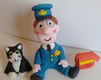 Handmade edible Postman Pat inspired cake topper set