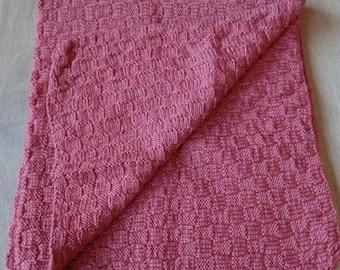 Handmade, knitted baby blanket