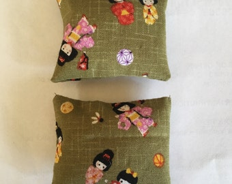 A set of two large 1:12 scale dollhouse cushions