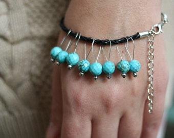 8  natural turquoise faceted stone knitting stitch markers on a bracelet
