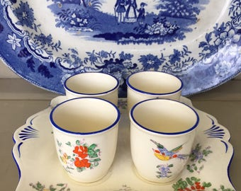 A Set of Four Vintage Egg Cups with a China Tray