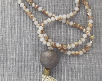 Golden necklace with crystals with wood pellet