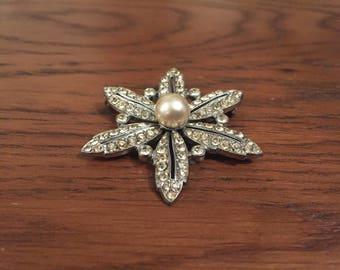 Silver star-shaped vintage brooch