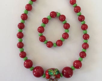 This cute American Girl Doll jewelry set features a red Cloisonne focal bead and red and green jade beads.