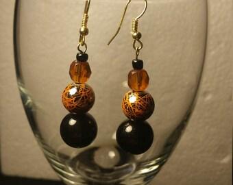 Orange and black glass earrings