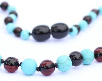 Cherry Baltic Amber with Howlite Gemstones.
