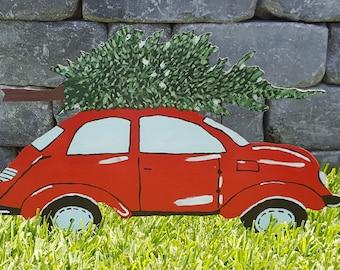 Adorable Yard Art Car transporting Christmas Tree!