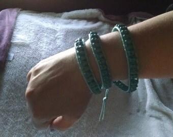 Three-wrap turquoise skull bracelet