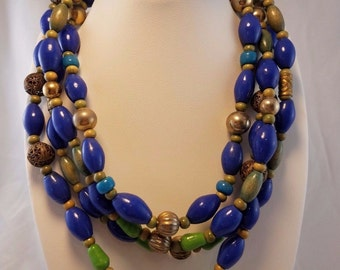 Vintage Art Deco brass and blue lapis bead and green wood bead necklace