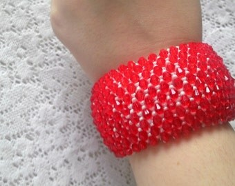 Bracelet is handmade using white and red  beads