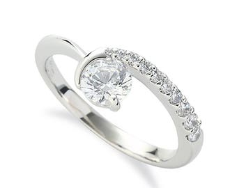 originally styled diamond engagement ring with 0.33ct of SI clarity  diamonds