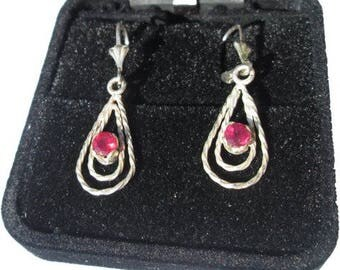Handmade silver earrings with ruby