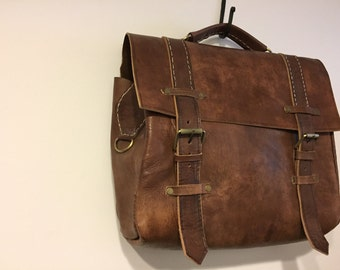 A gorgeous brown distress leather bag made in Morocco
