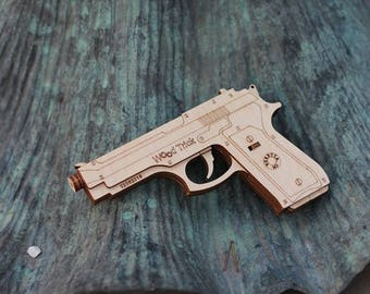 The GUN - WOODTRICK 3D Mechanical Wooden model for self assembly
