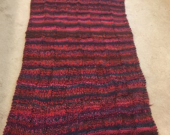 Basketweave knit afghan in reds
