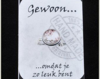 Sweet Adjustable ring with 12 mm cabochon with image of blossom. On a nice card with compliment