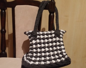 Hand knitted, two-coulored purse, with tough crochet handles and satin lining