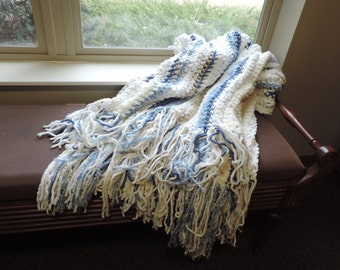 plush blue and white throw with fringe