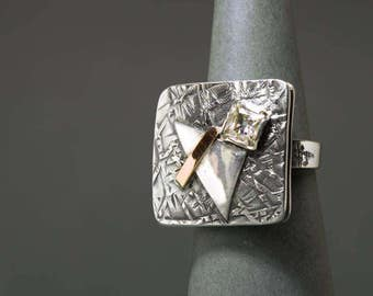 Silver ring with a gold element and Cubic Zirconia
