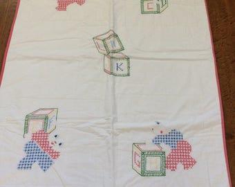 Vintage child's or crib blanket / alphabet blanket / hand embroidered / primary colors / cat / dog / rabbit / bear