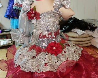 Pageant dress with sparkle and lace up back.