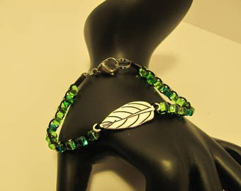 Green glass bead bracelet with silver leaf centerpiece
