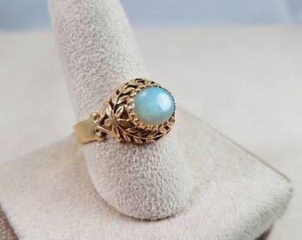 14k yellow gold opal ring laurel motif