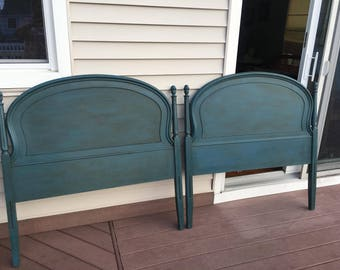 1/2 price sale! Antique blue twin headboards. Pick up only please