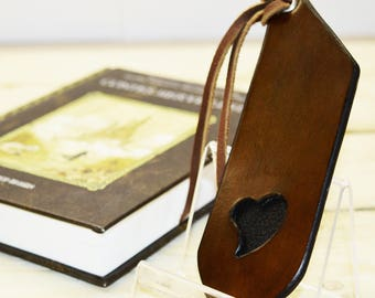 Rigid leather inlaid heart bookmarks.