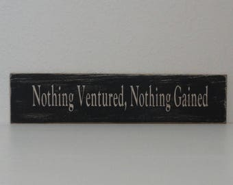 """Distressed sign: """"Nothing Ventured, Nothing Gained"""""""