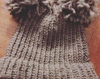 Knitted hat with puffs