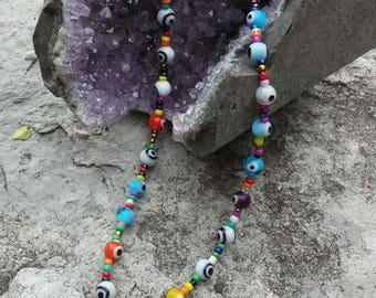 Quartz crystal pendant on glass bead necklace