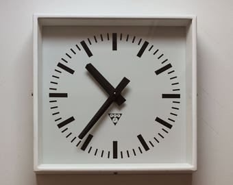 Vintage metal industrial wall clock from 70s/80s made in Czechoslovakia, refurbished AA battery, white matt coating