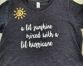 Girls t-shirt depicting the happy, playful side versus a potential sassy, meltdown, wild child. Sunshine and hurricane all in one!