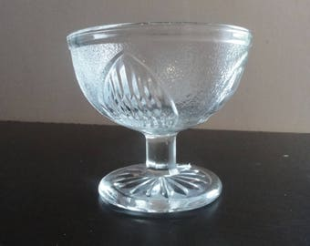 Clear pressed glass sherbet dish with leaf pattern