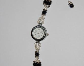 Watch with black onyx gemstones