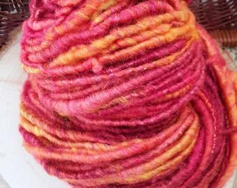 Red Dwarf: SW Merino wool/Tussah Silk Rockstar Handspun - red/orange/gold tones, corespun, 68 yds of softness and squish