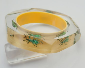 Yellow faceted lucite bracelet with six exotic real beetles