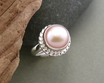 Pink button pearl ring in sterling silver
