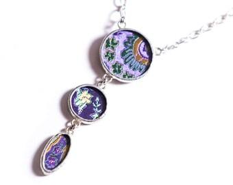 Shi Studio Trio Necklace in Silk Brocade behind Glass