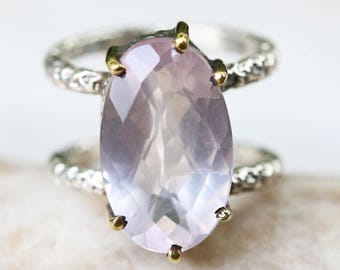 Oval rose quartz ring in silver bezel and brass prongs setting with sterling silver oxidized texture design double band