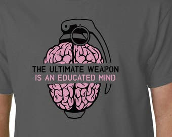 The Ultimate Weapon Is An Educated Mind t-shirt // Anonymous Geek Humour Political