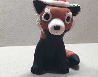 Red Panda with a Santa Hat Ornament by Shelly Schwartz