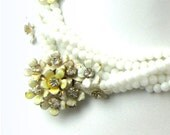 Vintage Sandor White Necklace accented with White & Pale Yellow Enamel Flowers and Enamel Flower clip on Earrings