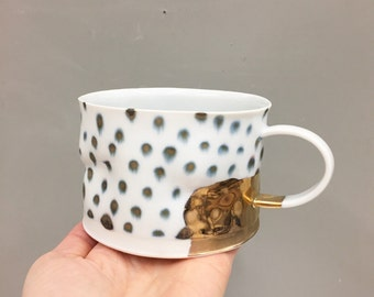 Gold & polka porcelain cup