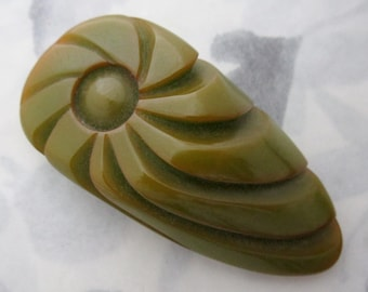 Vintage green carved bakelite dress clip - j6420