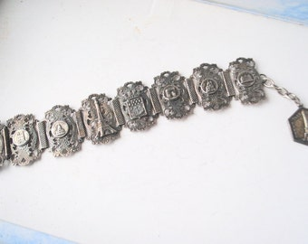 Art nouveau vintage 30s, silvertone metal, 8 links, souvenir, adjustable  bracelet with a  famous  place of Paris.
