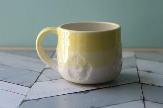 yellow and white mug, porcelain