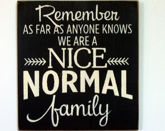 Remember as far as anyone knows were a nice NORMAL family wood sign